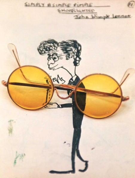 A pair of John Lennon's glasses rests 08 September